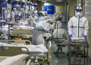 In this Thursday, Feb. 6, 2020, photo, medical workers treat patients in the isolated intensive care unit at a hospital in Wuhan in central China's Hubei province. China's virus death toll have surpassed the number of fatalities in the 2002-03 SARS epidemic, but fewer new cases were reported in a possible sign its spread might be slowing as other nations stepped up efforts to block the disease. (Chinatopix via AP)